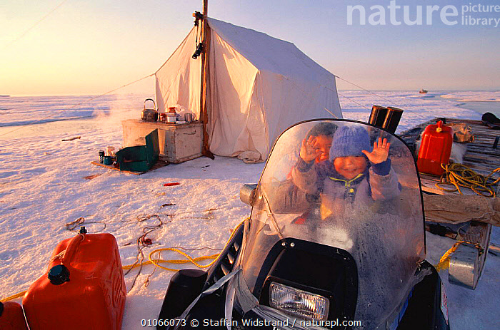 Inuit children at hunter's camp site, Baffin Island, Nunavut, Canada. Nataniel & Goulvan. Model released., ARCTIC,CAMPING,HUNTING FOOD,LANDSCAPES,PEOPLE,TENT,TRIBES,VERTICAL,North America,CANADA,Catalogue1, Staffan Widstrand