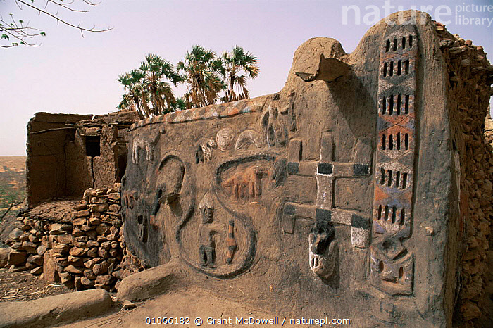 Nature picture library dogon mural relief carving on side of