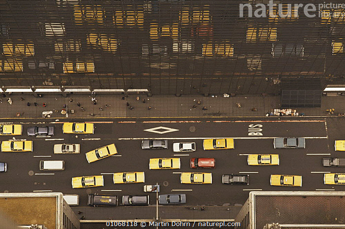 Aerial view of yellow taxi cabs and other traffic reflected in glass of skyscraper in New York city, USA, ARTY SHOTS,BUILDINGS,CITIES,HORIZONTAL,NORTH AMERICA,ROADS,URBAN,USA,VEHICLES,YELLOW,cars,aerials, Martin Dohrn