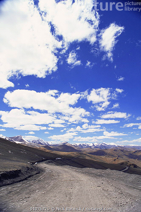 Views north to Ladakh from Taglang La, at 5328m on the World's 2nd highest motorable pass, India  ,  ASIA,CLOUDS,HIGH ALTITUDE,INDIAN SUBCONTINENT,LANDSCAPES,MOUNTAINS,PEACEFUL,ROADS,SKY,TRACKS,VERTICAL,Concepts,Weather,INDIAN-SUBCONTINENT  ,  Nick Barwick