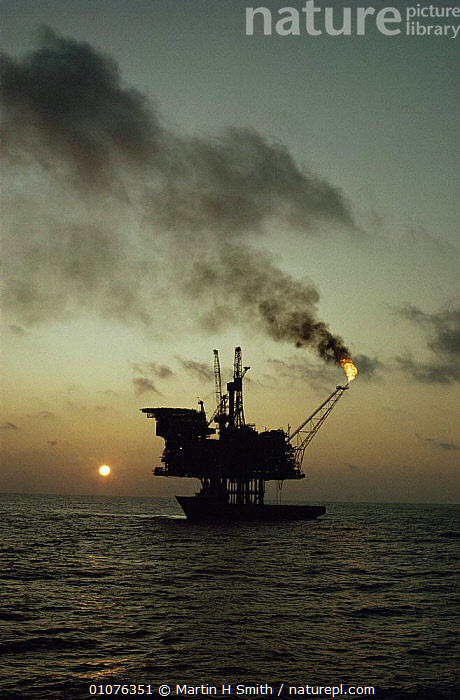 Oil rig with supply ship North Sea  ,  BOATS,ENERGY,EUROPE,FIRE,VERTICAL  ,  Martin H Smith
