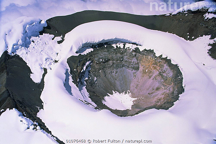Aerial view of Cotopaxi volcano crater, covered in snow, Ecuador, South America 2000  ,  CRATER,LANDSCAPES,SNOW,SOUTH AMERICA,VOLCANOES,Geology  ,  Robert Fulton