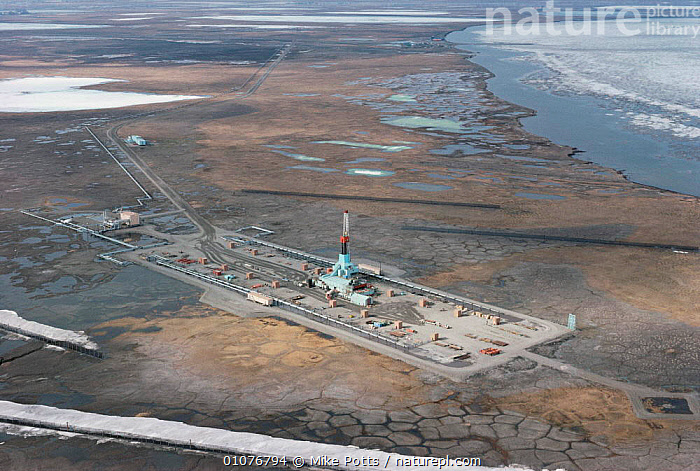 Aerial view of oil drilling rig on coastal wetlands, Prudhoe Bay, Alaska, USA 1988  ,  AERIALS,BUILDINGS,COASTAL WATERS,COASTS,CRUDE OIL,ENERGY,INDUSTRIAL,INDUSTRY,LANDSCAPES,MINING,NORTH AMERICA,ROADS,TUNDRA,USA,WETLANDS  ,  Mike Potts