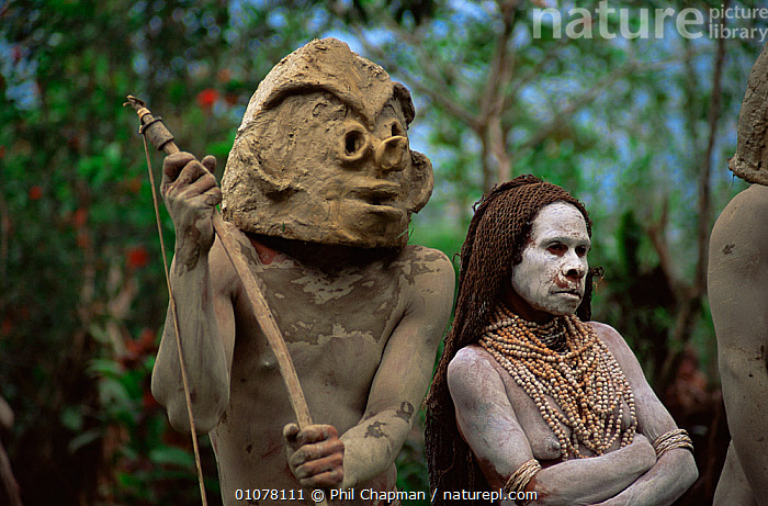 Asaro mudman with wife at traditional dance ceremony, Mount Hagen, Papua New Guinea, 1991  ,  ASIA,CLAY,CLOTHING,CULTURES,DANCE,DANCING,INDONESIA,INTERESTING,MALE FEMALE PAIR,MT,MUD,PEOPLE,SOUTH EAST ASIA,TRADITIONAL,TRIBES,WEST-AFRICA  ,  Phil Chapman