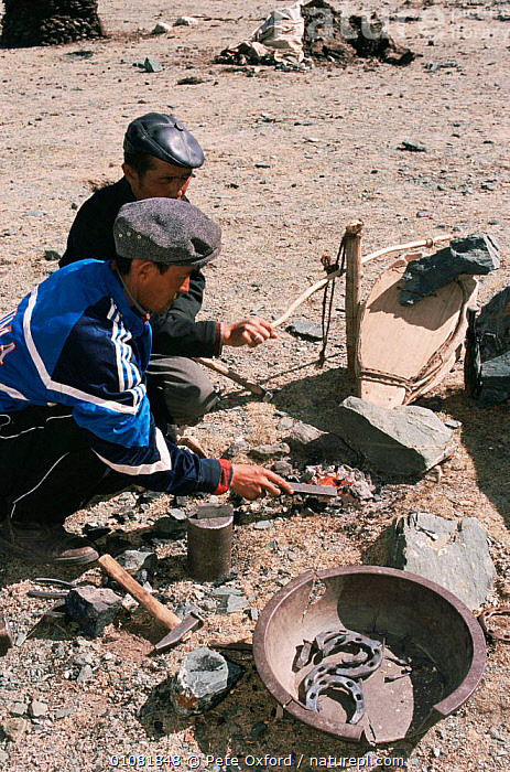 Kazakh nomads making metal horse shoes nr Tsengle Khairkhan Mt, Western Mongolia. 2001  ,  ASIA,MONGOLIA,PEOPLE,TRADITIONAL,VERTICAL  ,  Pete Oxford