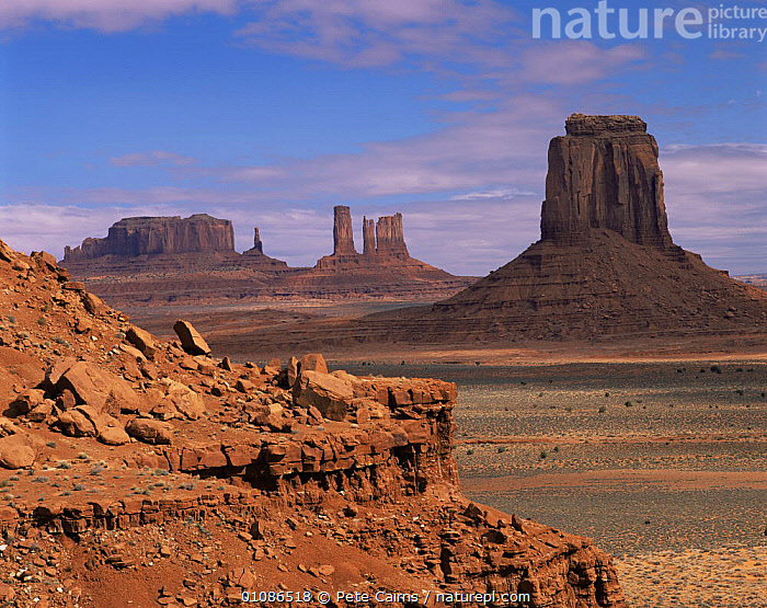 Monument Valley landscape with sandstone monoliths, Navajo Tribal Park, Utah, USA  ,  DESERTS,HORIZONTAL,LANDSCAPES,LARGE,NORTH AMERICA,PEACEFUL,ROCK FORMATIONS,ROCKS,USA,Concepts,Geology  ,  Pete Cairns