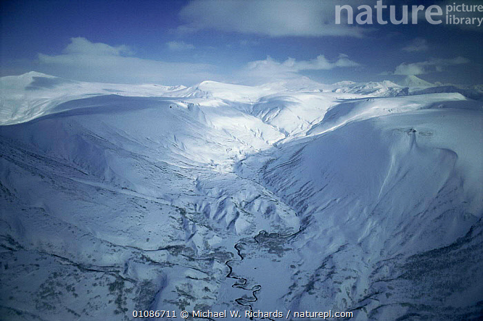 Aerial view over snow covered mountains, Kamchatka wilderness, Russia  ,  Aerial,altitude,ASIA,COLD,HABITAT,HIGHLANDS,LANDSCAPES,MOUNTAINS,PEACEFUL,RUSSIA,SNOW,WINTER,Concepts,CIS  ,  Michael W. Richards