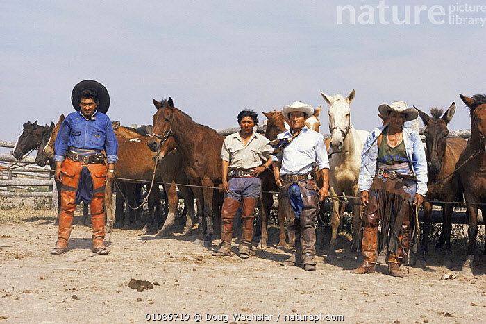 Paraguayan cowboys by their horses, Peones, Chaco, Paraguay, South America, 1995  ,  COWBOYS,CULTURES,DOMESTIC,HORSES,LIVESTOCK,MALES,MEN,PEOPLE,SOUTH AMERICA,TRADITIONAL,WORKING,SOUTH-AMERICA  ,  Doug Wechsler