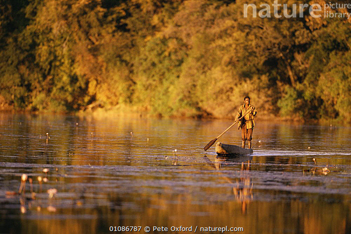 Local man in Mokoro, canoering along river, Okavango Delta, Botswana, Southern Africa  ,  AFRICA,BOATS,HORIZONTAL,MAN,PEOPLE,RIVERS,SOUTHERN AFRICA,WATER  ,  Pete Oxford
