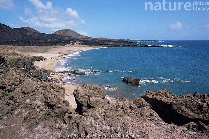 Volcanic coastal landscape, Ascension Island, Mid Atlantic 1987  ,  ATLANTIC,ATLANTIC OCEAN,BEACHES,COASTAL WATERS,COASTS,LANDSCAPES,MARINE,SEA,SOUTH ATLANTIC ISLANDS,WAVES  ,  Mike Potts