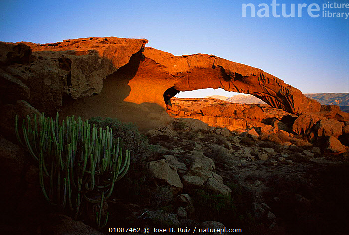 Natural arch at sunset, Tabaibarril coast, Tenerife, Canary Islands  ,  ARCHES,CANARIES,DUSK,EUROPE,GEOLOGY,LANDSCAPES,PEACEFUL,ROCK FORMATIONS,ROCKS,SPAIN,SUNSET,Concepts,CANARY ISLANDS  ,  Jose B. Ruiz