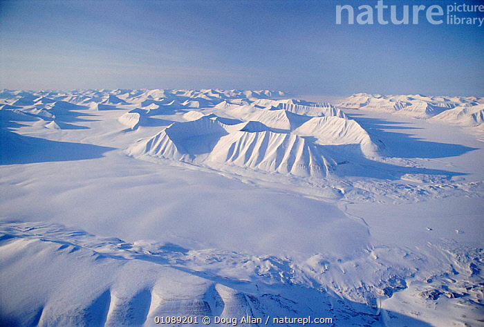 Aerial of frozen peaks and sea ice in winter Svalbard, Norway, AERIAL VEIWS,ARCTIC,BLUE PLANET,COLD,DA,FROZEN,HORIZONTAL,ICE,LANDSCAPES,PEAKS,SCANDINAVIA,SNOW,WINTER ,AERIALS,Europe, Scandinavia, Scandinavia, Scandinavia, Scandinavia, Scandinavia, Scandinavia, Scandinavia, Scandinavia, Doug Allan