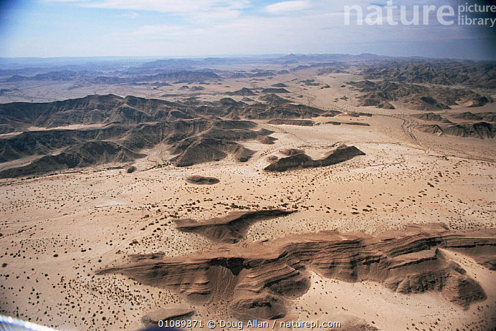 Aerial view of desert landscape with rocky hills and dry river course, Namibia, AFRICA,DESERTS,DRY SEASON,LANDSCAPES,RIVERS,SAND DUNES,SOUTHERN AFRICA, Doug Allan