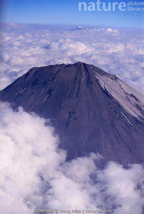 Sangay volcano rising above clouds Ecuador, AERIAL,CLOUDS,DA,GEOLOGY,SANGAY,SOUTH AMERICA,VERTICAL,VOLCANOES,VOLCANOS,WEATHER ,AERIALS, Doug Allan