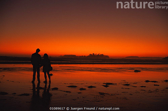 Man and woman against red sky after sunset on sandy beach, British Columbia, Canada, BEACHES,CANADA,COASTAL WATERS,COASTS,COUPLE,HOLIDAY,HORIZONTAL,PEACEFUL,PEOPLE,RED,SILHOUETTES,SKIES,SKY,SUNSET,North America,Concepts, Jurgen Freund