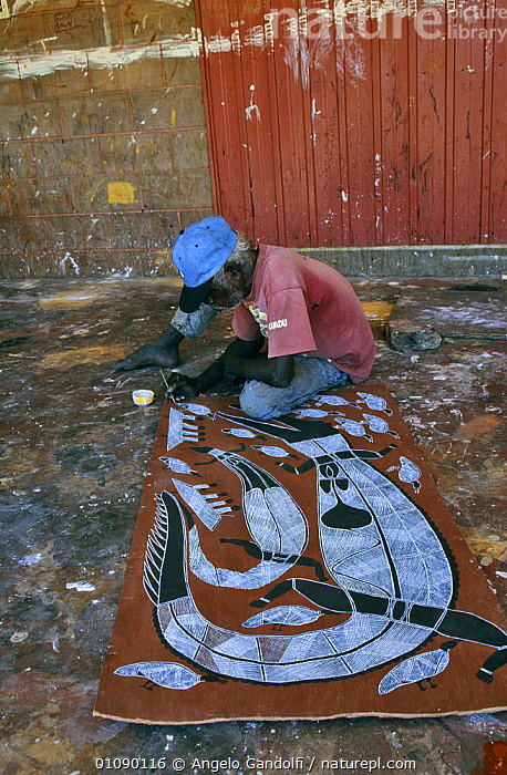 Aborigine painting on bark Oenpelli village, Arnhem land, Northern Territory, Australia, ANIMALS IN ART,ART,AUSTRALASIA,AUSTRALIA,BARK,CRAFTMANSHIP,CRAFTS,CULTURES,PAINTING,PEOPLE,TRADITIONAL,TRIBES,VERTICAL,WORKING,Plants, Angelo Gandolfi