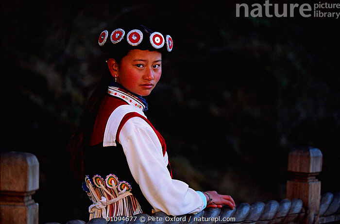 Naxi woman (ethnic minority) in traditional costume Lijiang town, Yunnan, China  ,  CLOTHING,COSTUME,ETHNIC,FEMALES,HORIZONTAL,PEOPLE,PO,TRADITIONAL,TRIBES,VERTICAL,WOMAN,Asia,CHINA  ,  Pete Oxford