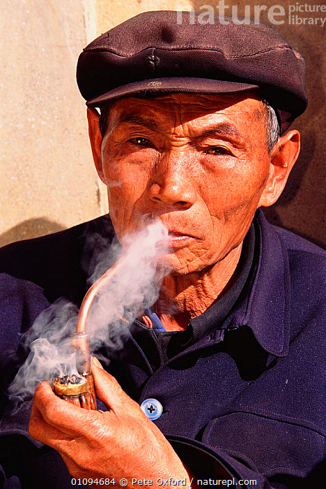 Han man smoking pipe Shilin, Yunnan, China. 2002  ,  ASIA,CHINESE,FACES,MAN,PETER,PIPES,PO,PORTRAITS,SMOKE,SMOKING,TRADITIONAL,VERTICAL,CHINA  ,  Pete Oxford