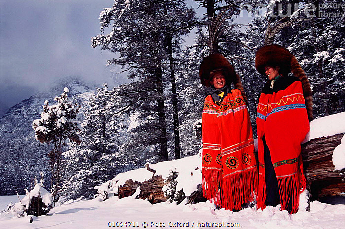 Red panda fur hats worn by Yi people (ethnic minority) in winter. Lijiang, Yunnan, China 2001  ,  ANIMAL,ASIA,CARNIVORES,CHINESE,CLOAKS,CLOTHING,COLOURFUL,COSTUME,ETHNIC,FUR,HATS,HORIZONTAL,LANDSCAPES,MAMMALS,PEOPLE,PO,SKIN,SNOW,TAILS,TRADITIONAL,TRIBES,TWO,WINTER,CHINA  ,  Pete Oxford