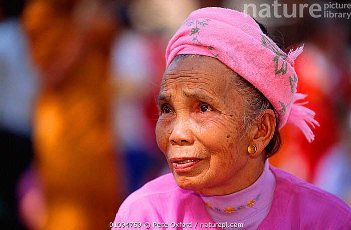 Dai woman, Xishuangbanna, Yunnan, China -  minority Buddhist group who wear colourful clothes and long skirts 2001  ,  ASIA,CHINESE,CLOTHES,COLOURFUL,FACES,HATS,HORIZONTAL,MINORITY,PEOPLE,PINK,PO,PORTRAITS,TRADITIONAL,TRIBES,WOMAN,CHINA  ,  Pete Oxford