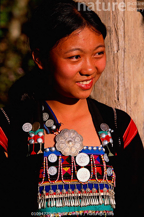 Aini woman in traditional costume Xishangbanna area, Yunnan, China. Ethnic minority group. 2002  ,  ASIA,CHINESE,CLOTHES,COSTUME,DETAIL,GROUP,JEWELLERY,MINORITY,PEOPLE,PO,TRADITIONAL,TRIBES,VERTICAL,WOMAN,CHINA  ,  Pete Oxford