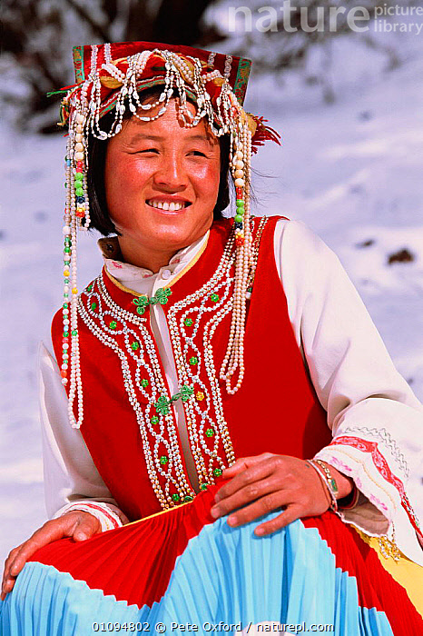 Nosi Yi woman with traditional three coloured long summer dress Lijiang, Yunnan, China. Ethnic minority group 2002  ,  ASIA,CHINESE,COLOURFUL,COSTUME,LADY,LONG,MINORITY,ONE,PEOPLE,PO,TRADITIONAL,TRIBES,VERTICAL,WOMAN,CHINA  ,  Pete Oxford