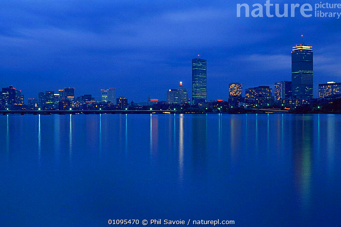 Boston cityscape at night over the Charles River, Boston, Massachusetts, USA  ,  BUILDINGS,CITIES,cityscapes,DUSK,LIGHTS,NIGHT,NORTH AMERICA,REFLECTIONS,RIVERS,URBAN,USA,WATER  ,  Phil Savoie