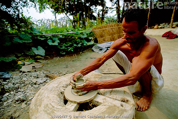 Potter turning clay pot on wheel, Majuli Island, Assam, India, ASIA,HORIZONTAL,INDIAN SUBCONTINENT,MAKING,MAN,PEOPLE,POTTER,POTTERY,TRADITIONAL,WORKING,INDIA,INDIAN-SUBCONTINENT, Bernard Castelein