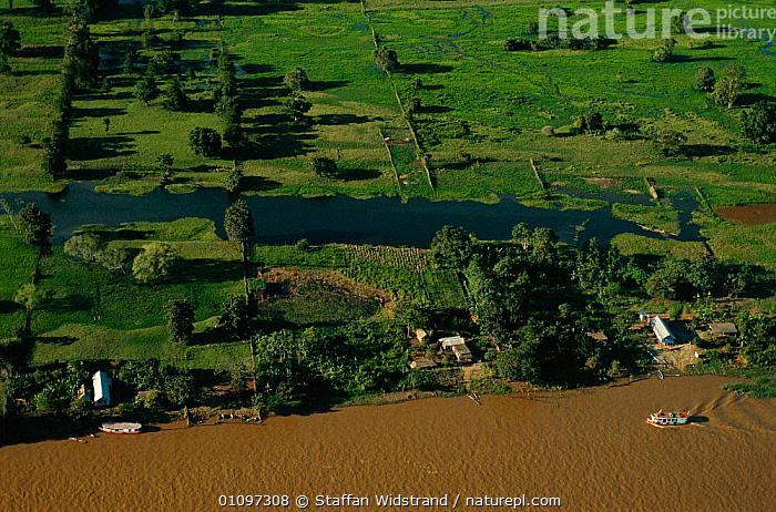 Aerial view of Amazon river with boat and settlements on embankment, Brazil, Amazonas, AERIAL,AMAZONIA,AMERICA,BOATS,HABITAT,HOMES,HOUSES,LANDSCAPES,RIVERS,SAILING,SCENICS,SHIPS,SOUTH,WATER,WETLANDS,SOUTH-AMERICA, Staffan Widstrand