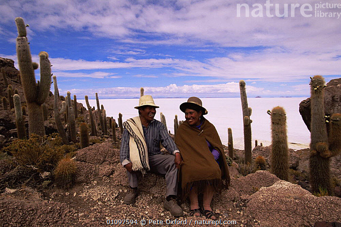 Aymara couple living on Inkawasi Island, Uyuni Salt Pan, SW Bolivia, South America, CACTUS,CULTURES,FEMALES,HIGHLANDS,MALE FEMALE PAIR,MALES,MINERALS,PEOPLE,PLANTS,SALT,SOUTH AMERICA,TRADITIONAL,TRIBES,SOUTH-AMERICA, Pete Oxford