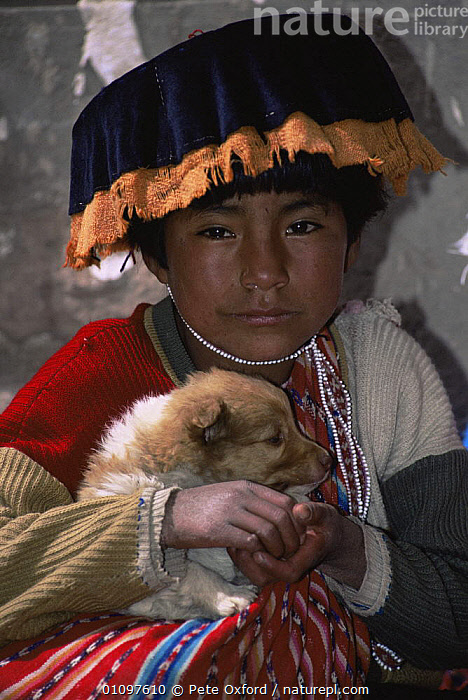 Small child with puppy at Pisac market, Highlands, Peru, South America, BABIES,CHILD,CHILDREN,CLOTHING,CULTURES,CUTE,DOGS,FACES,HIGHLANDS,JUVENILE,PEOPLE,PETS,PORTRAITS,SMALL,SOUTH AMERICA,TRADITIONAL,VERTICAL,SOUTH-AMERICA, Pete Oxford