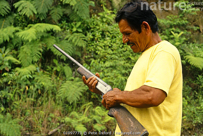 Colonizers holding a gun, Ecuadorian Amazon, 1994, GUNS,MALES,MEN,PEOPLE,SOUTH AMERICA,TROPICS,WEAPONS, Pete Oxford