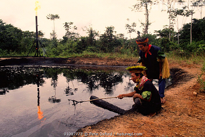 Cofan Indians inspecting waste pit, Rio Agua Rico, Dureno, Ecuadorian Amazon, AMAZONIA,BURNING,CONFLICT,CONSERVATION,CULTURES,ECUADOR,ENVIRONMENTAL,FIRE,FLAMES,INDUSTRY,LANDSCAPES,MINING,OIL,PEOPLE,POLLUTION,RAINFOREST,SOUTH AMERICA,TRADITIONAL,TRIBAL,TRIBES,TROPICAL,WASTE,WATER,WELL,WETLANDS, Pete Oxford