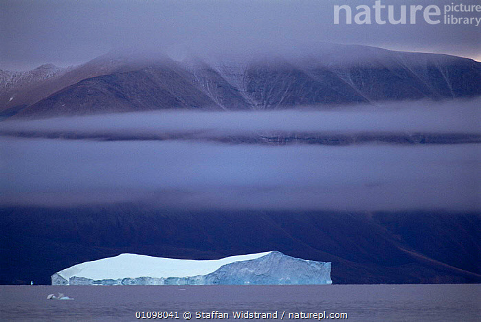 Iceberg with land behind, Qaanaaq, Greenland, ARCTIC,EUROPE,ICE,ICEBERGS,LANDSCAPES,GREENLAND, Staffan Widstrand