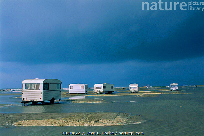 Caravans on land flooded by sea Camargue, France  ,  WEATHER,BEACHES,LANDSCAPES,FLOODING,COASTS,BEACHES,VEHICLES,FLOODS,Europe  ,  Jean E. Roche