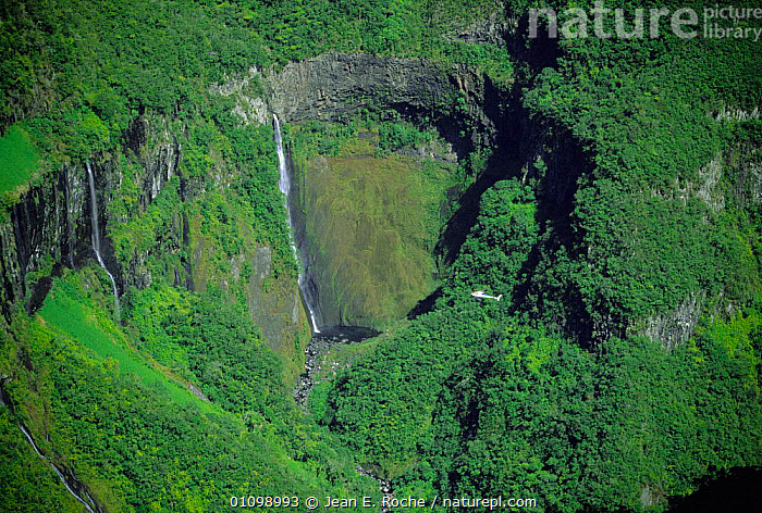 Aerial view of Bras de Caverne with helicopter hovering above canyon, La Reunion Island, Indian Ocean  ,  AERIALS,AIRCRAFT,ASIA,CLIFFS,FORESTS,GEOLOGY,Indian Ocean,Islands,LANDSCAPES,lush,TROPICAL,tropical rainforest,WATERFALLS,Marine  ,  Jean E. Roche