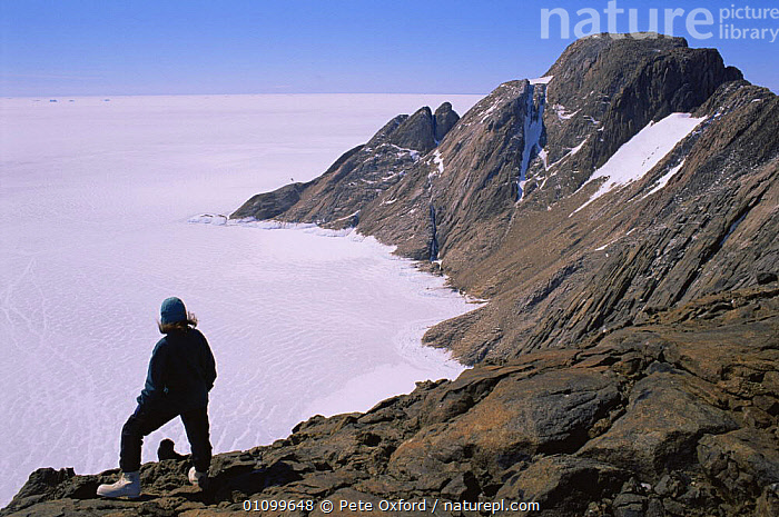 Person standing on Scullin Monolith, Australian Antarctic Territory, Antarctica December  ,  ANTARCTICA,CLOUDS,EROSION,HIGHLANDS,HORIZONTAL,LANDSCAPES,PATTERNS,PEOPLE,POLAR,ROCK FORMATIONS,ROCKS,STANDING,WEATHER,WIND,Geology  ,  Pete Oxford
