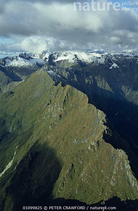 Aerial view of Mount Cook, looking to Tasman Sea, South Island, New Zealand  ,  AERIALS,AUSTRALASIA,CLOUDS,COLD,HIGHLANDS,LANDSCAPES,MOUNTAINS,NEW ZEALAND,RANGE,RIDGE,SNOW,SUMMIT,VERTICAL,Weather  ,  PETER CRAWFORD