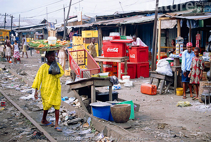 Street scene in the Bidonville slums of Lagos, Nigeria, West Africa 2002  ,  AFRICA,CHILD,CHILDREN,CITIES,CITY,FL,HORIZONTAL,MARKET,PEOPLE,POPULATION,POVERTY,SHANTY,SHANTY TOWN,SHANTY TOWNS,SLUM,STALLS,STREET,WEST AFRICA,WEST-AFRICA  ,  Fabio Liverani