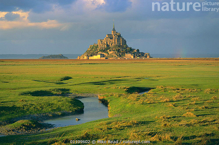 Mont St Michel in evening light with storm clouds, Normandy, France, LANDMARK,LANDSCAPES,ISLAND,HISTORIC,SCENICS,SCENIC,SUNSET,HORIZONTAL,BUILDINGS,WETLANDS,Europe, Mike Read
