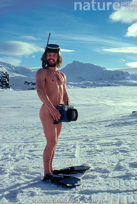 Doug Allan, BBC Natural History Unit cameraman without wetsuit, but with beard and camera. Antarctic, 1985. Antarctica, ANTARCTICA,DA,EQUIPMENT,HUMOROUS,MALES,NUDITY,ONE,PEOPLE,PORTRAIT,VERTICAL,CONCEPTS, Doug Allan