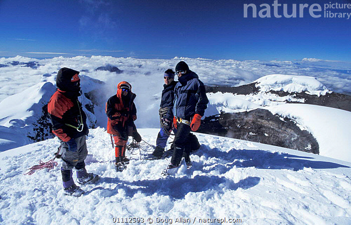 Climbers on summit of Cotopaxi volcano (5947m/19500ft) Ecuador 2002  ,  CLIMBING,LANDSCAPES,MOUNTAIN,MOUNTAINS,PEOPLE,SNOW,TOP,VOLCANOES,GEOLOGY  ,  Doug Allan