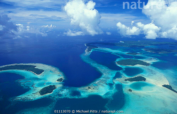 Aerial view of outlying islands, Central Province, Solomon islands, Melanesia  ,  CLOUDS,CORAL REEFS,LANDSCAPES,OCEANIA,PACIFIC,PACIFIC OCEAN,SEA,SKY,TROPICAL,MARINE,WEATHER ,AERIALS,MELANESIA  ,  Michael Pitts