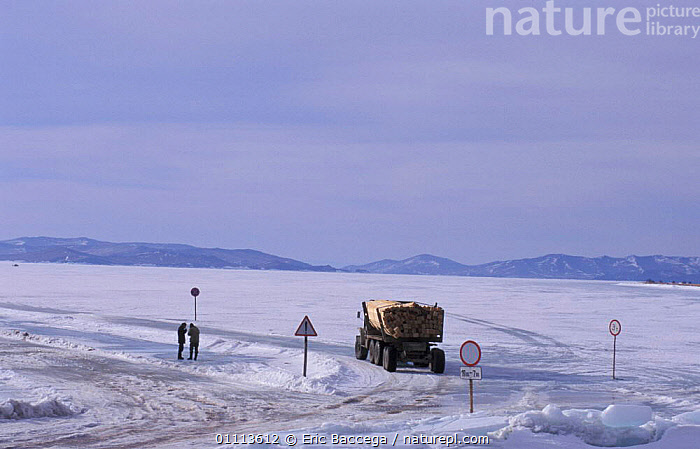 Lorry driving across frozen ice of Lake Baikal in winter, Siberia, Russia  ,  INTERESTING,LAKES,LANDSCAPE,LANDSCAPES,PEOPLE,VEHICLES ,RUSSIA,CIS  ,  Eric Baccega