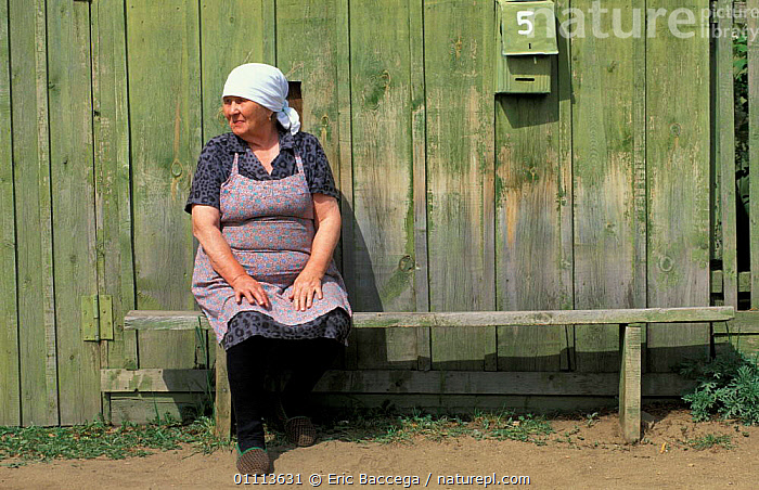 Woman sitting outside wooden house, Rougir village, Olhkon Is, Lake Baikal, Siberia, Russia  ,  LADY,BUILDINGS,PEOPLE,TRADITIONAL ,RUSSIA,CIS  ,  Eric Baccega