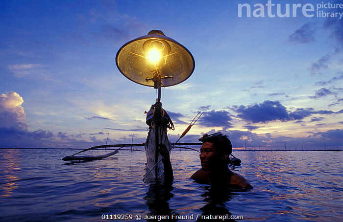 Seahorse fisherman with banka (outrigger boat) and lantern. Bohol Is, Philippines  ,  TROPICAL,TRADE,BOAT,BOATS,TRADITIONAL,LANDSCAPES,LANTERN,PEOPLE,SEAHORSES,NIGHT,FISH,FISHERIES,MARINE,OUTRIGGER,LIGHT,SOUTH-EAST-ASIA,Asia  ,  Jurgen Freund