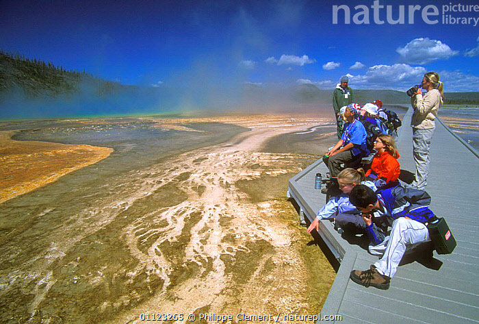 Tourists on boardwalk looking at thermophile mats, formed by algae, bacteria and other heat loving micro-organisms, Black Sand Basin, Yellowstone  ,  COLOURFUL,GEOTHERMAL,LANDSCAPES,MINERALS,NORTH AMERICA,NP,PEOPLE,RESERVE,US,WALKWAY,Geology,National Park,USA  ,  Philippe Clement