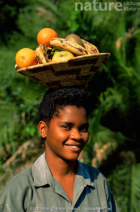 Local woman balancing basket of fruit on head, Okavango Delta, Botswana  ,  AFRICA,PEOPLE,PORTRAITS,SOUTHERN AFRICA,VERTICAL,WOMAN  ,  Pete Oxford
