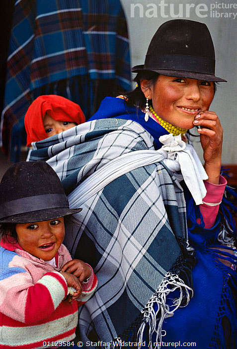 Quechua indian mother carrying baby on her back, Zumbahua, Ecuador.  ,  FAMILIES,LANDSCAPES,PEOPLE,TRIBES,VERTICAL,WOMAN  ,  Staffan Widstrand