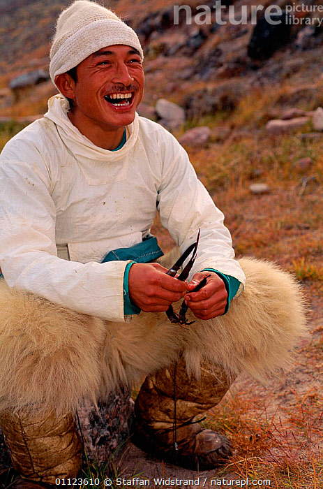 Inuit Narwhal hunter with Polar bear skin trousers, Qaanaaq, NW Greenland.  ,  ARCTIC,BEARSKIN,CLOTHES,FUR,HUNTING FOOD,LANDSCAPES,PELT,PEOPLE,PORTRAITS,TRADITIONAL,VERTICAL,GREENLAND,Catalogue1  ,  Staffan Widstrand
